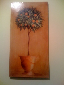 A painting of an orange tree